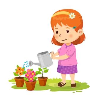 식물에 물을 주는 귀여운 소녀