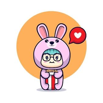 토끼 의상과 팝콘을 입고 귀여운 소녀