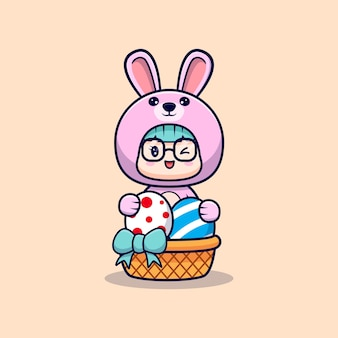 토끼 의상을 입고 귀여운 소녀 부활절 날 장식 달걀을 잡아