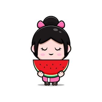 スイカの漫画イラストを保持している着物のドレスを着ているかわいい女の子