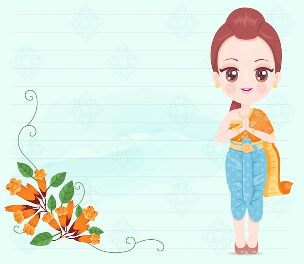 オレンジ色のタイのドレスを着ているかわいい女の子