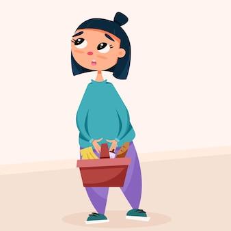 彼女の手に食料品のバスケットを持つかわいい女の子