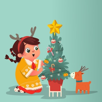 머리띠를 한 귀여운 소녀가 사슴 인형으로 크리스마스 트리를 장식하고 있습니다