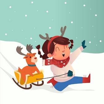 크리스마스 이브를 축하하기 위해 작은 사슴과 함께 눈 속에서 썰매를 연주하는 머리띠를 한 귀여운 소녀