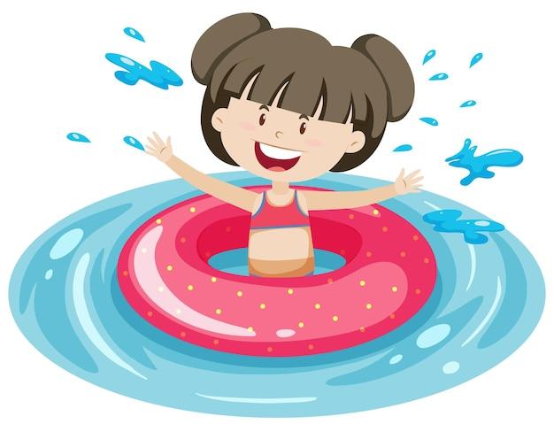 隔離された水にピンクの浮き輪を持つかわいい女の子