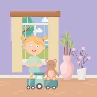 Cute girl with train and teddy in the home, kids toys