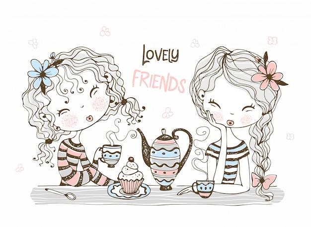 Cute girlfriends drink tea.