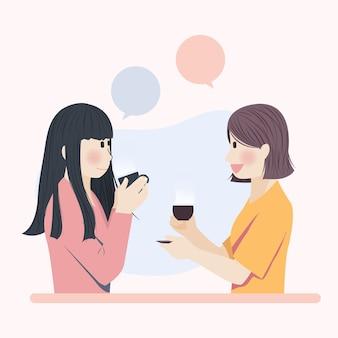 Симпатичные девушки болтают за напитком