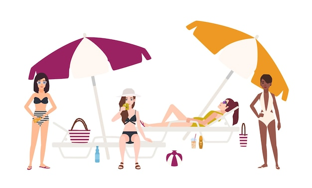 Cute girls dressed in swimsuits lying and sitting on sunloungers with umbrellas or standing beside it, relaxing and sunbathing