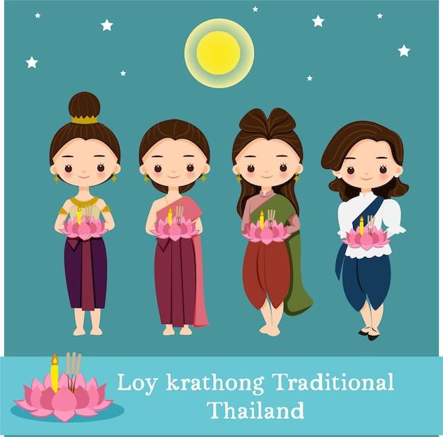 Милые девушки в традиционной одежде на фестивале лой кратонг в таиланде