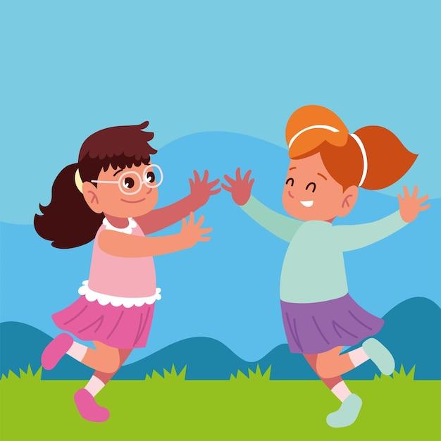 Милые девушки прыгают в траве