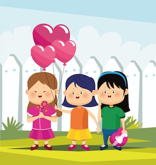 Cute girls with flowers, chocolate box and heart balloons over white fence