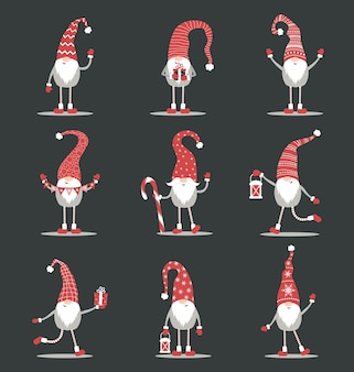 Cute gnomes in red santa hats on black background. scandinavian christmas elves.