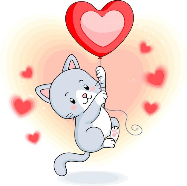 ハートのバルーンで飛んでかわいい灰色の子猫