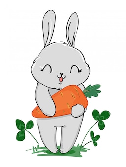 ニンジンとクローバーの白い背景で隔離を保持しているかわいい灰色のウサギ。