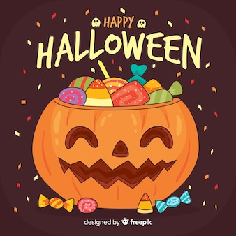 Cute halloween background in flat design with pumpkin and candies