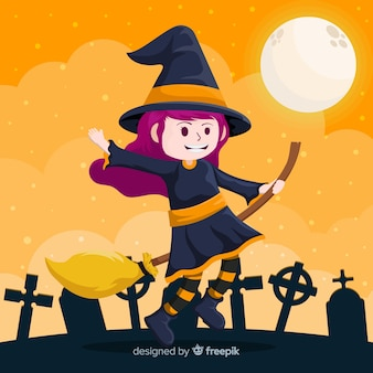 Cute halloween witch in cemetery