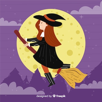 Cute halloween witch at night time