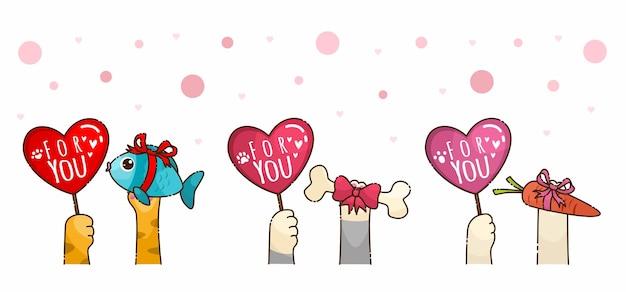 バレンタインギフトを与えるかわいい手猫犬のウサギ