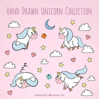 Carino disegnati a mano unicorni in situazioni diverse