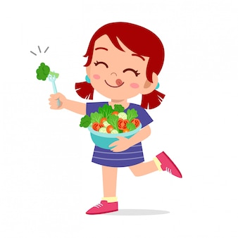 Cute happy kid eats salad