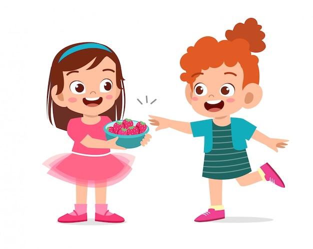 Cute happy kids eating strawberries