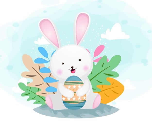 Cute happy smiling bunny hugging easter egg