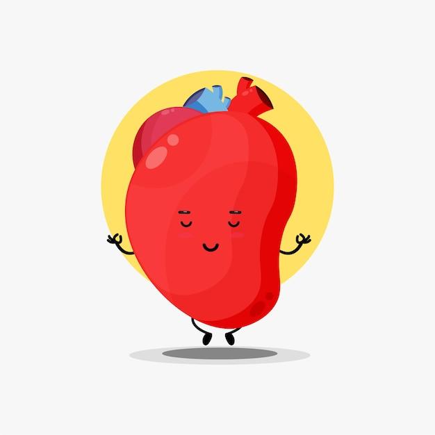 ヨガのポーズで瞑想するかわいい心臓器官のキャラクター