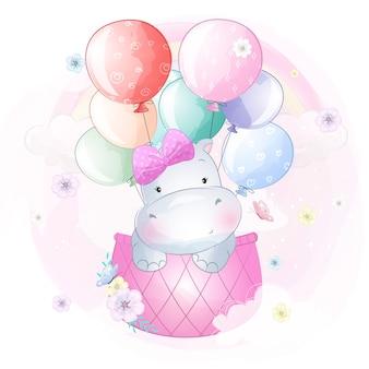 Милый бегемот летит с воздушным шаром