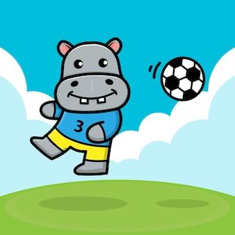 Милый бегемот играет в футбол иллюстрация