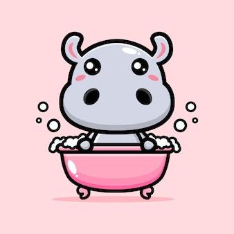 ピンクの浴槽で入浴するかわいいカバ