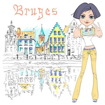 かわいい流行に敏感な女の子は、ベルギーの背景に美しい中世の家々を背景に、ブルージュ運河の美しい街の景色を自撮りします。