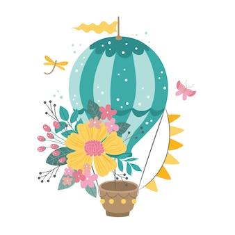 美しい花の花輪とかわいい熱気球