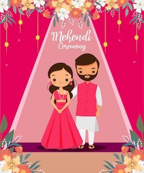 Cute indian couple in pink traditional dress for mehendi ceremony on their wedding day