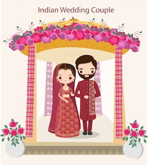 Cute indian couple in traditional wedding dress standing under the wedding mandap