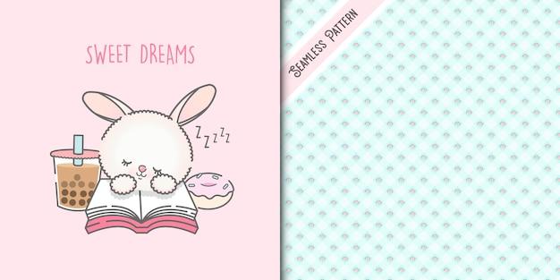 Милый кролик каваи спит на книге и зеленый фон