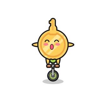 The cute key character is riding a circus bike , cute design