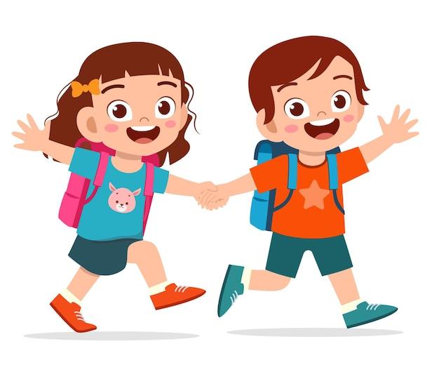 Милый ребенок мальчик и девочка держатся за руку и вместе ходят в школу