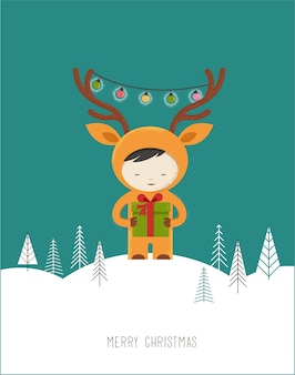 Милый ребенок в костюме рождества оленя.