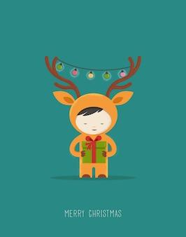 사슴 크리스마스 의상에서 귀여운 꼬마입니다.