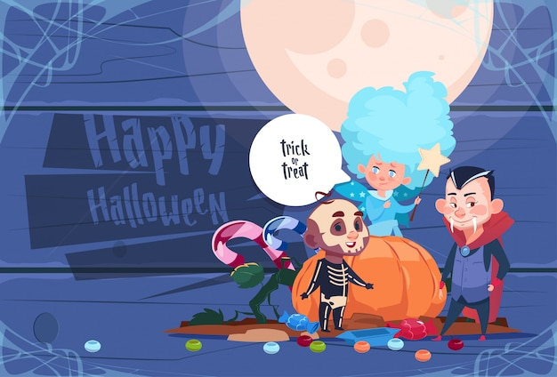 Cute kid wear bat costume with pumpkin, happy halloween party celebration concept