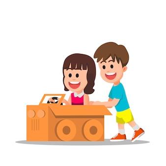 Cute kids playing with cardboard