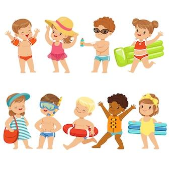 Cute kids toons are having fun on the beach