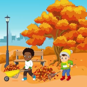 Милые дети-волонтеры убирают осенние листья в городском парке