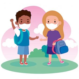 コロナウイルスcovid 19を防止するために医療用マスクを着ているかわいい子供たちはランドセルで19