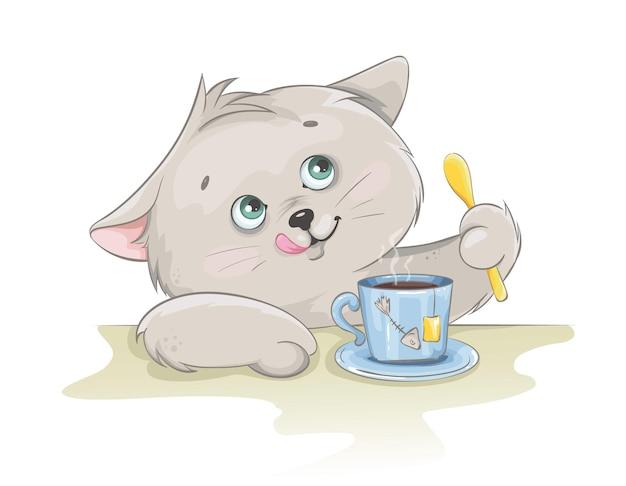 Милый котенок с чашкой чая