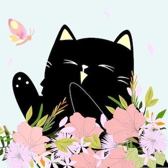 Cute kitten kitty cat in the flower garden with butterfly