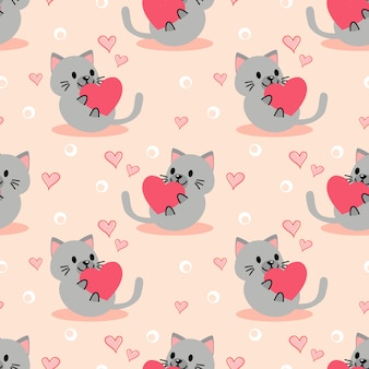 Cute kitten and pink heart seamless pattern.