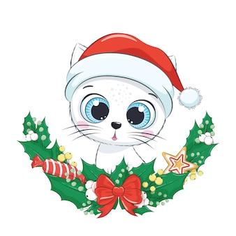 クリスマスリースとかわいい子猫。