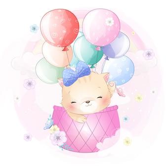 Милый котенок летит на воздушном шаре